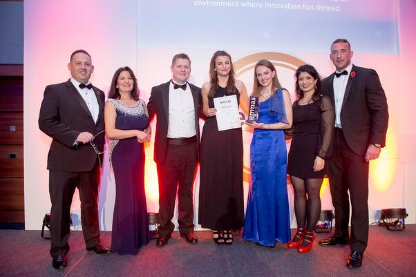 Jeremy Chandar, Marianne Walsh, Wesley Bourne, Lara Hone and Marilyn Webster collect Bournes EMMA award for international moving company of the year 2016